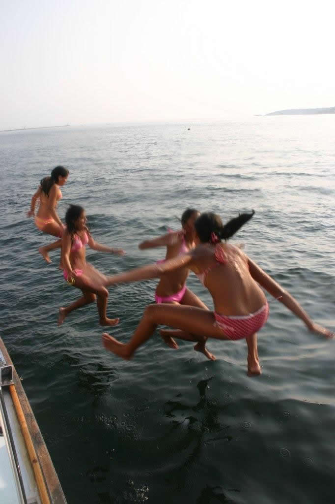 Girls jumping into the water
