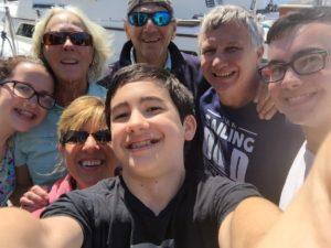 Lorrie, family & Captains Raffi & Lisa